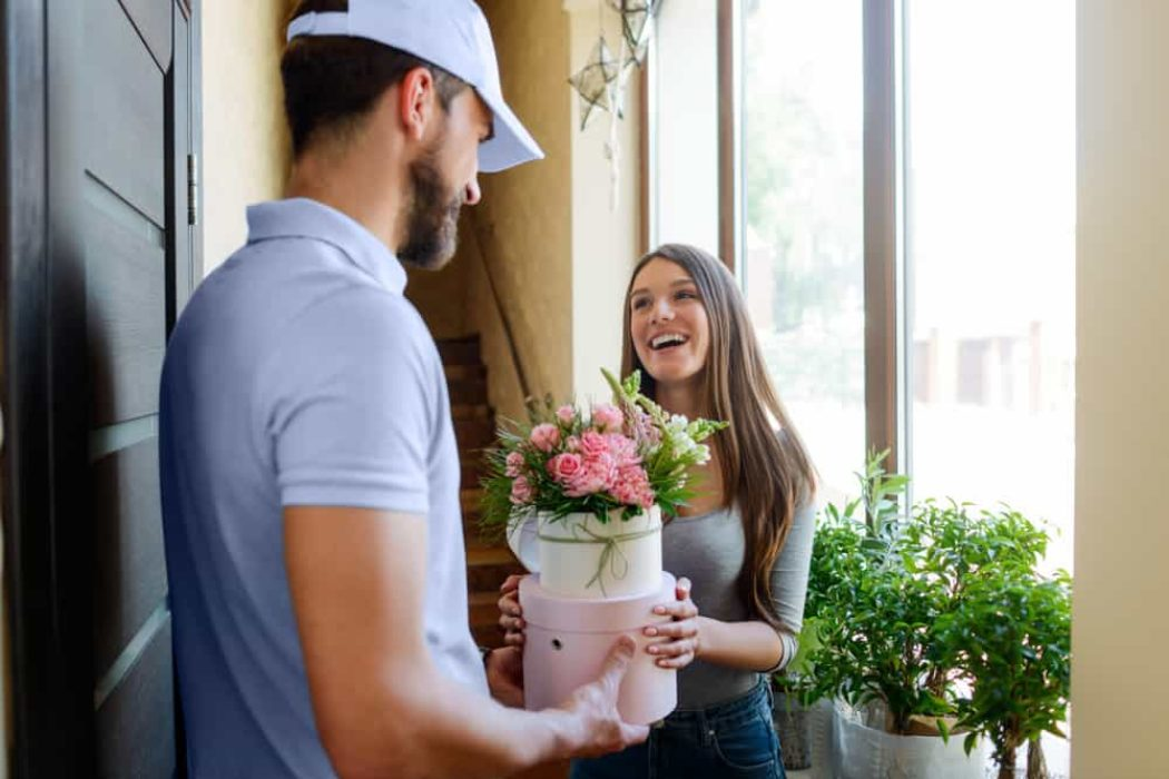 Happy,Woman,Received,A,Bouquet,From,A,Courier.,Box,With