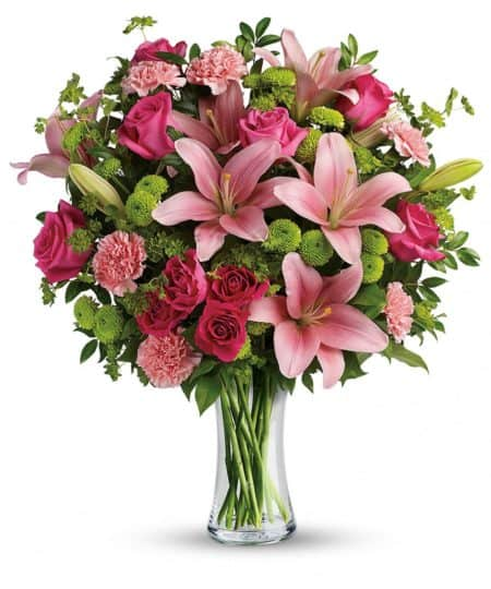 Gorgeously girly! Like sending a party in a vase, this breathtaking bouquet of blushing roses and lilies is a positively pink-tastic way to celebrate someone special.